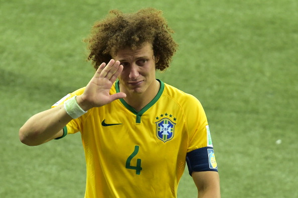 Brazil's defender David Luiz walks off the pitch after losing the semi-final football match between Brazil and Germany at The Mineirao Stadium in Belo Horizonte on July 8, 2014, during the 2014 FIFA World Cup.   AFP PHOTO / GABRIEL BOUYS        (Photo credit should read GABRIEL BOUYS/AFP/Getty Images)